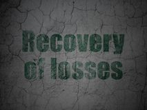 Currency concept: Recovery Of losses on grunge wall background. Currency concept: Green Recovery Of losses on grunge textured concrete wall background Royalty Free Stock Photos