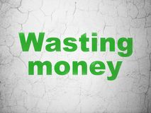 Currency concept: Wasting Money on wall background Royalty Free Stock Image