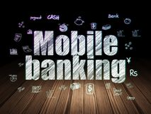 Currency concept: Mobile Banking in grunge dark room. Currency concept: Glowing text Mobile Banking,  Hand Drawn Finance Icons in grunge dark room with Wooden Royalty Free Stock Images