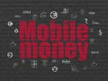 Currency concept: Mobile Money on wall background. Currency concept: Painted red text Mobile Money on Black Brick wall background with  Hand Drawn Finance Icons Stock Photos