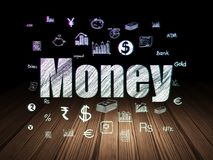 Currency concept: Money in grunge dark room. Currency concept: Glowing text Money,  Hand Drawn Finance Icons in grunge dark room with Wooden Floor, black Royalty Free Stock Photos