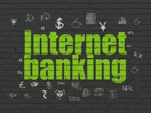 Currency concept: Internet Banking on wall background. Currency concept: Painted green text Internet Banking on Black Brick wall background with  Hand Drawn Royalty Free Stock Photography