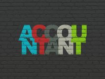 Currency concept: Accountant on wall background. Currency concept: Painted multicolor text Accountant on Black Brick wall background Stock Photography