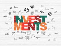 Currency concept: Investments on wall background. Currency concept: Painted multicolor text Investments on White Brick wall background with  Hand Drawn Finance Stock Photo