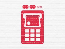 Currency concept: ATM Machine on wall background. Currency concept: Painted red ATM Machine icon on White Brick wall background Royalty Free Stock Images