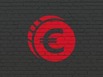 Currency concept: Euro Coin on wall background. Currency concept: Painted red Euro Coin icon on Black Brick wall background Stock Photos