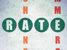 Currency concept: Rate in Crossword Puzzle. Currency concept: Painted green word Rate in solving Crossword Puzzle on Digital Data Paper background Stock Images