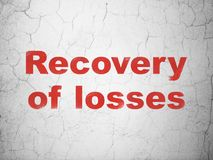 Currency concept: Recovery Of losses on wall background. Currency concept: Red Recovery Of losses on textured concrete wall background royalty free stock photos