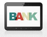 Currency concept: Tablet Pc Computer with Bank on  display. Currency concept: Tablet Pc Computer with Painted multicolor text Bank on display, 3D rendering Stock Photography