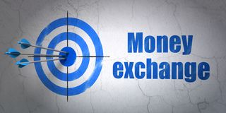 Currency concept: target and Money Exchange on wall background. Success currency concept: arrows hitting the center of target, Blue Money Exchange on wall Stock Photo