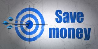 Currency concept: target and Save Money on wall background. Success currency concept: arrows hitting the center of target, Blue Save Money on wall background, 3D Royalty Free Stock Photo