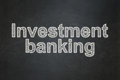 Currency concept: Investment Banking on chalkboard background. Currency concept: text Investment Banking on Black chalkboard background Royalty Free Stock Image
