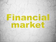 Currency concept: Financial Market on wall background. Currency concept: Yellow Financial Market on textured concrete wall background Royalty Free Stock Photography