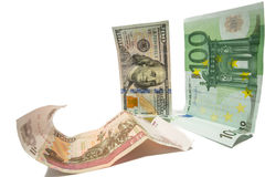 Currency dollar and euro looking at fallen russian ruble Royalty Free Stock Images