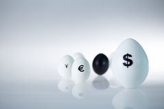 Currency eggs Royalty Free Stock Photography