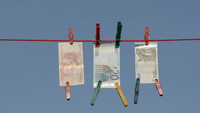Currency euro on clothes-line after money-laundering Stock Image