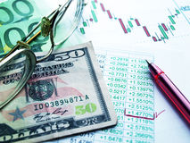 Currency exchange. Money laying on the table of an exchange rate of currency Royalty Free Stock Photography