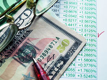 Currency exchange. Money laying on the table of an exchange rate of currency stock photo