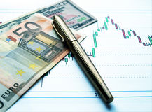 Currency exchange. Money laying on the table of an exchange rate of currency stock photos