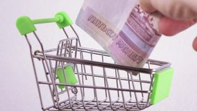 Currency exchange in the basket stock video footage