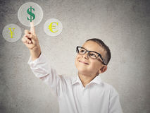 Currency Exchange Concept. Closeup portrait happy, smiling Child Touching Selecting Dollar sign button on currency Exchange Touchscreen display, grey wall stock photography
