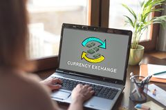 Currency exchange concept on a laptop screen. Laptop screen displaying a currency exchange concept Stock Photo