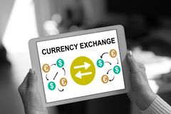 Currency exchange concept on a tablet. Currency exchange concept shown on a tablet held by a woman stock illustration