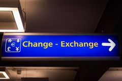 Currency exchange sign at the airport with money currency icon. For tourist and passenger royalty free stock image