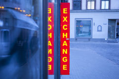 Currency exchange. Signboard currency exchange, reflection string in the glass Royalty Free Stock Photos