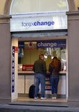 Currency exchange tourists. Two tourists changing money in Italy. Currency exchange Stock Images