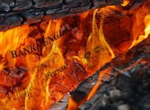 Currency in flames Stock Photo