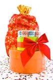 Currency gift and red bag on a white background Royalty Free Stock Images