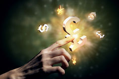 Currency glowing symbols Stock Image