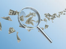 Currency and hand lens Stock Images