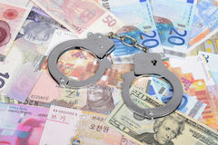 Currency with handcuffs Royalty Free Stock Photos