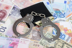Currency with handcuffs Royalty Free Stock Photo