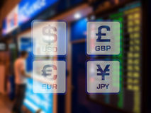 Currency icons on currency exchange booth at airport blurred bac Stock Image