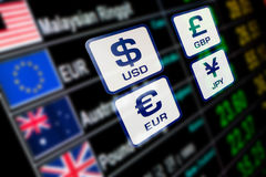 Currency icons signs exchange rate on digital display board. Blurred background Royalty Free Stock Photography