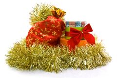 Currency New Year's gift in a tinsel. Currency New Year's gift in a golden tinsel on the white background Stock Images