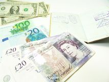 Currency and passport Royalty Free Stock Images