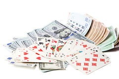 Currency and playing cards on a white background Stock Photos