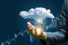 Currency symbols fall from the cloud to the hand . stock photo