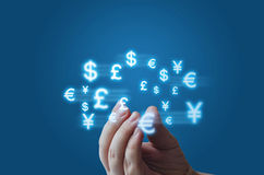 Currency symbols moving around the arm. Stock Image