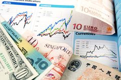 Currency with forex charts Stock Photo