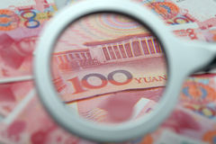 Currency under the magnifying glass Stock Images