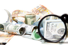 Currency under a magnifying glass Royalty Free Stock Photo