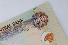 The Currency of the UAE - Close up of a thousand Dirham note  on a white background. Money exchange stock image