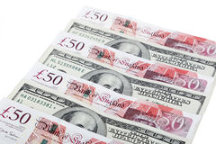 Currency. US dollars and British pounds on white background Royalty Free Stock Images