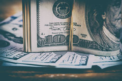 Currency US dollars. The US currency. Dollars related eraser on a wooden board.Background of success Royalty Free Stock Photos