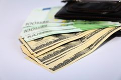Currency in the wallet. The money is in a black wallet stock image